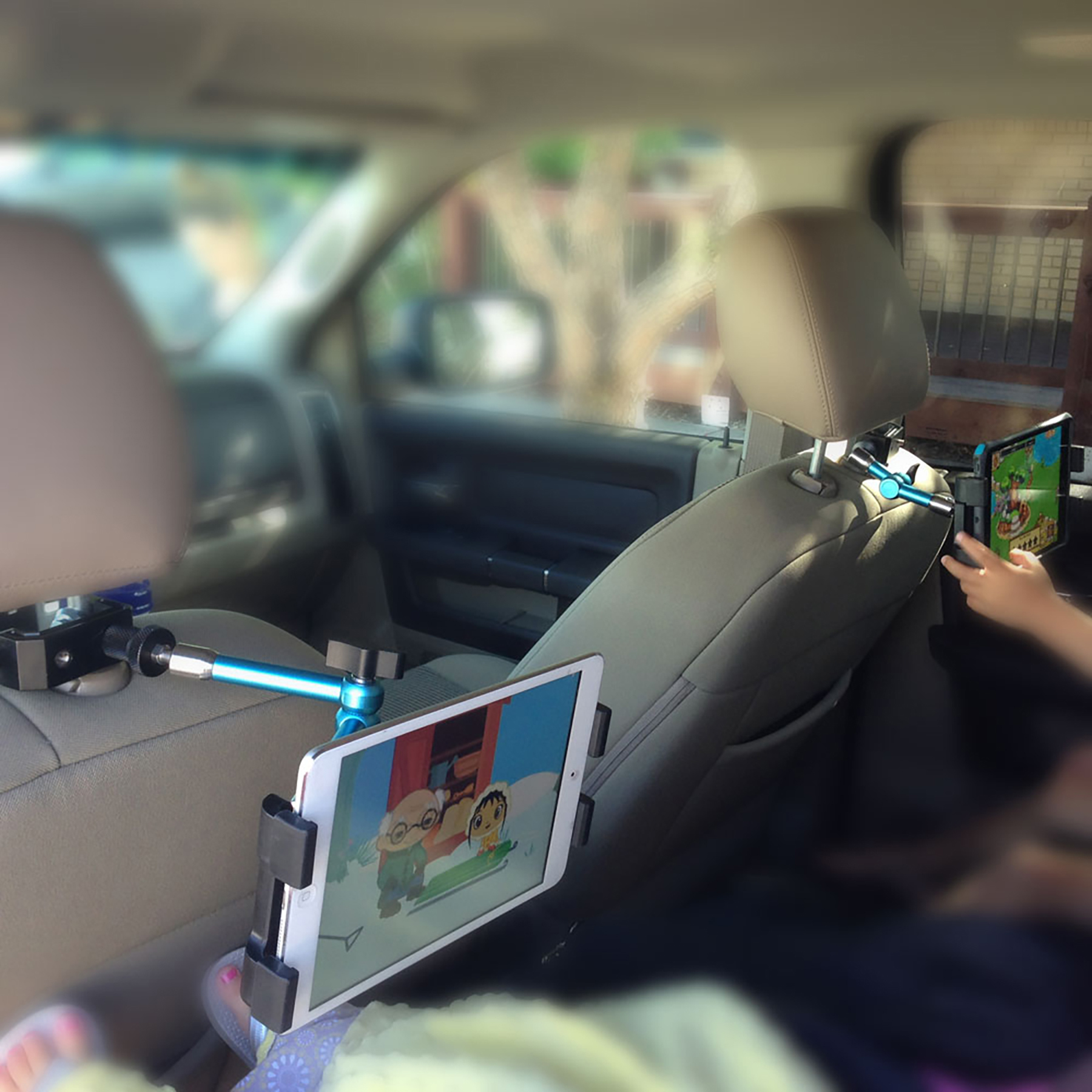 Keep those kids quiet in the back of the car with the help of this handy gadget.  Attaches your Tablet to virtually any surface:  desk, table, tripod, kitchen, bedroom, car headrest and anywhere else in your office or home, allowing you a more...