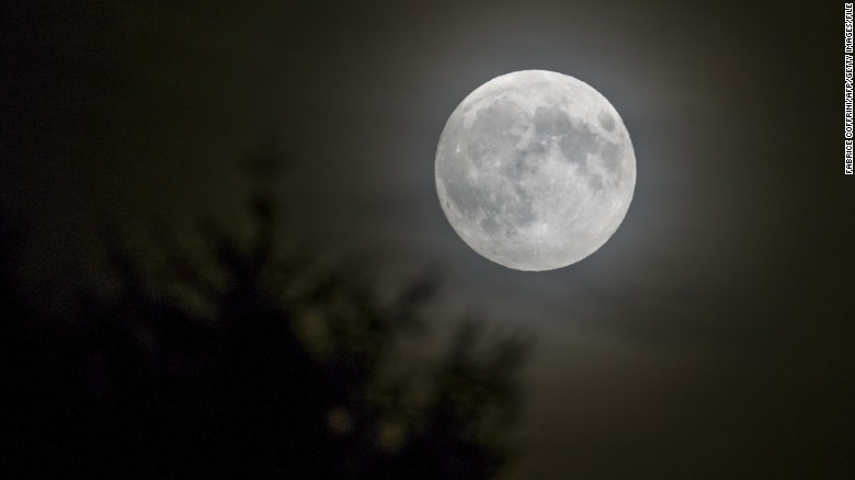A full moon is seen in Lausanne, Switzerland, in September. Look for one on Christmas morning._292168