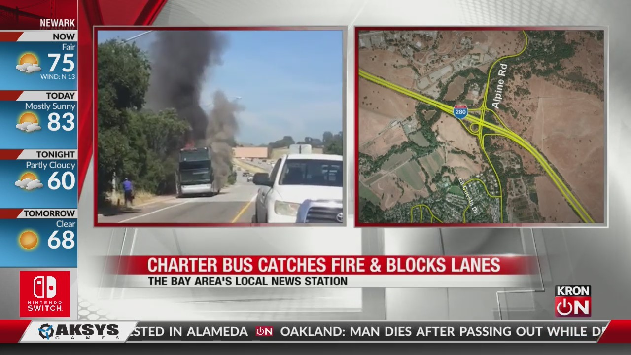 Charter bus catches fire, blocks lanes