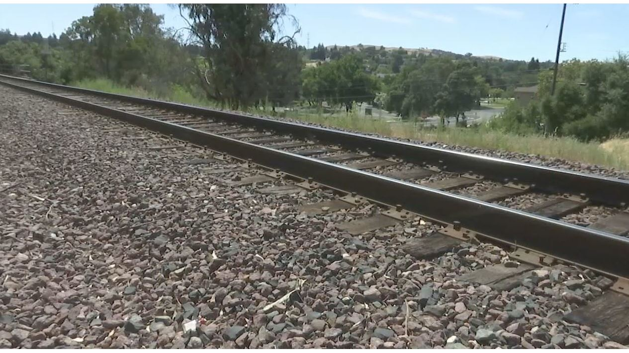 Woman hit, killed by train while walking along railroad tracks in