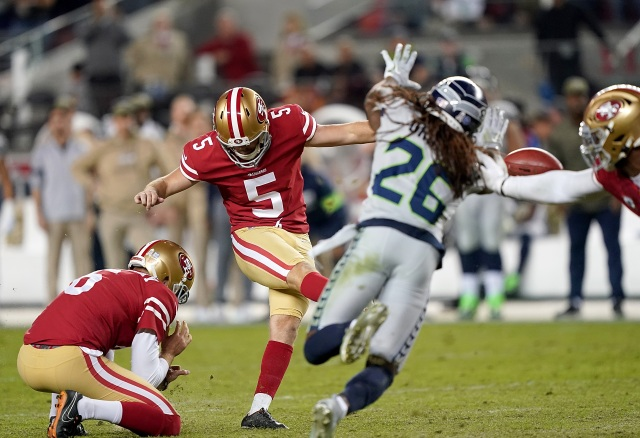 49ers fall to Seahawks in OT, ending undefeated streak