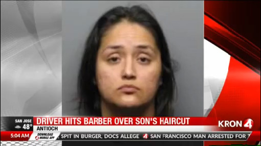 East Bay woman wanted after running over barber