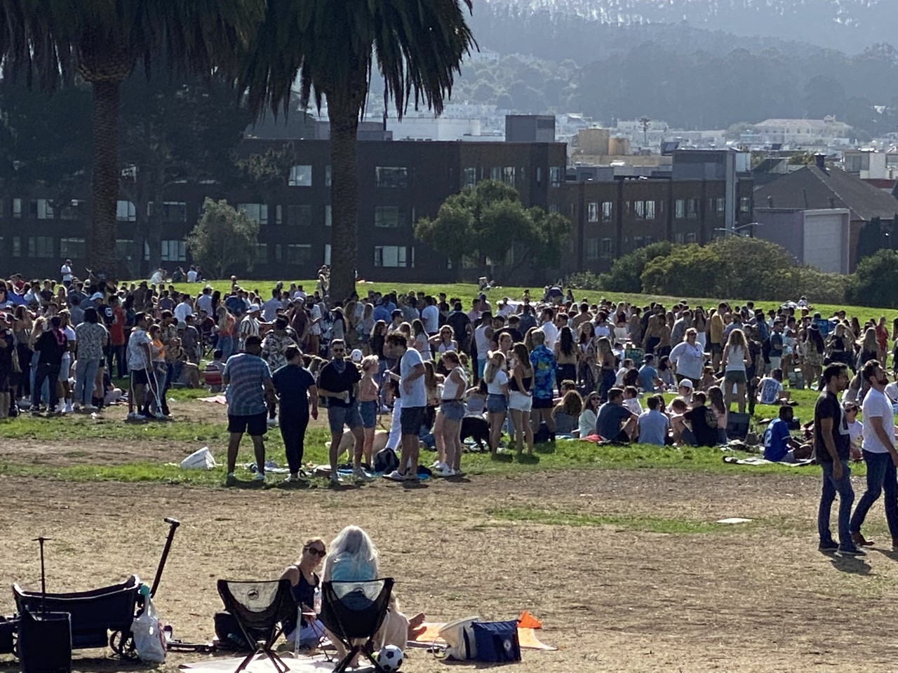 Large crowds gather at Fort Mason in San Francisco with little to no masks worn