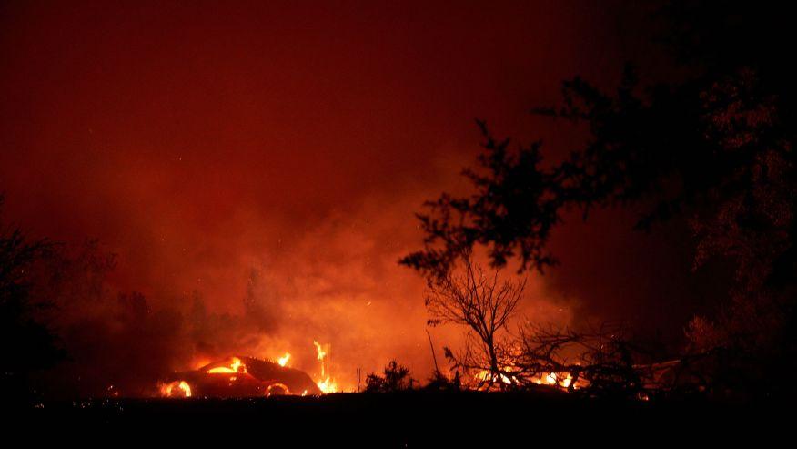 The fire burns a home along Platina Road in Igo, on September 27, 2020.