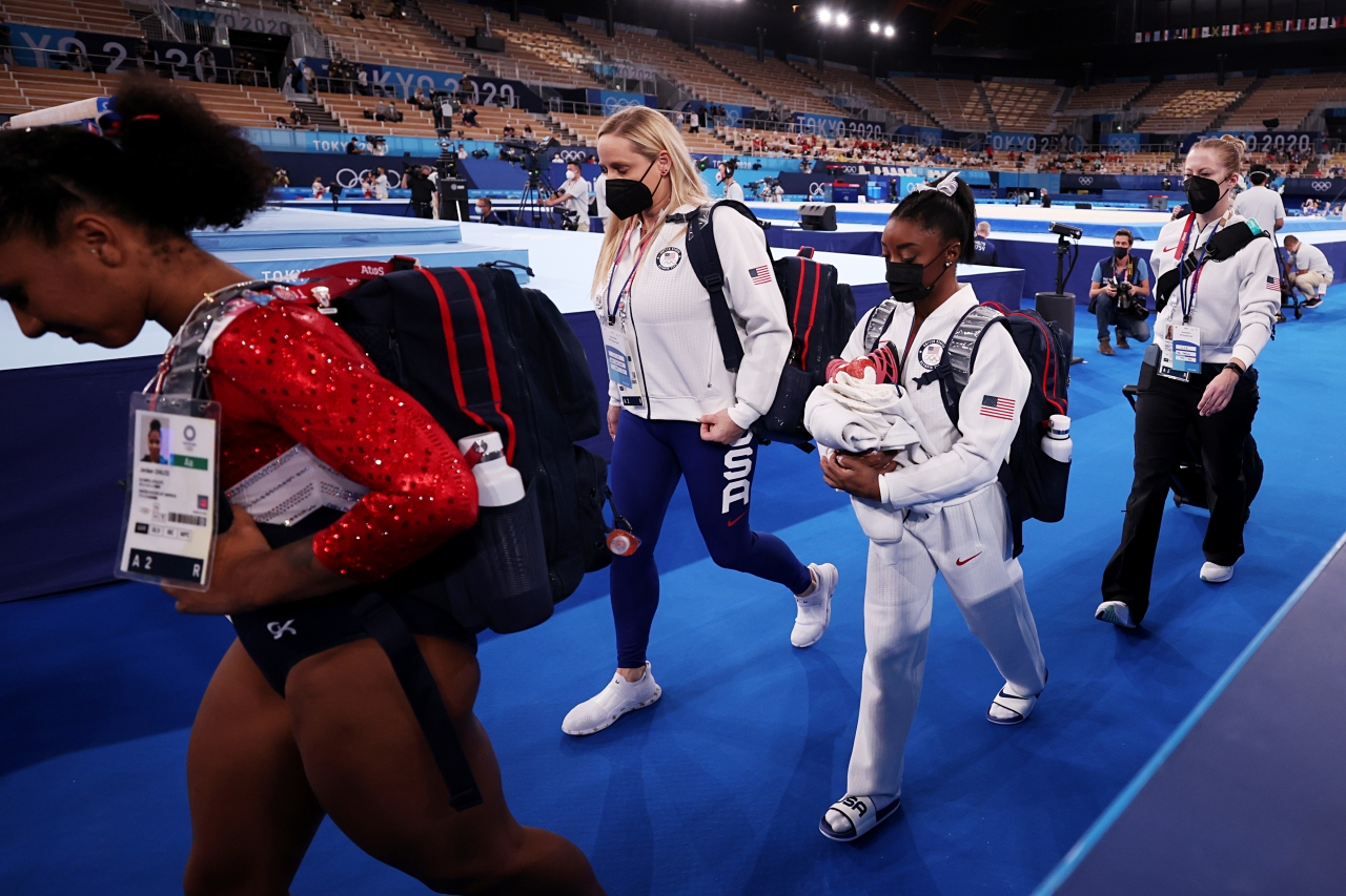 Simone Biles out of team finals