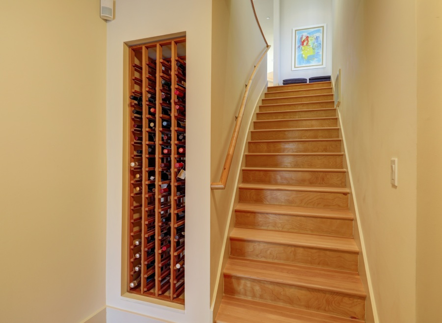 Massive wine cellar next to the staircase.