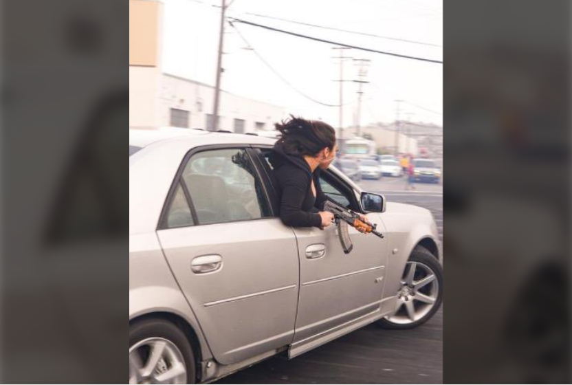 Woman leans out of car, holds AK47 in San Francisco